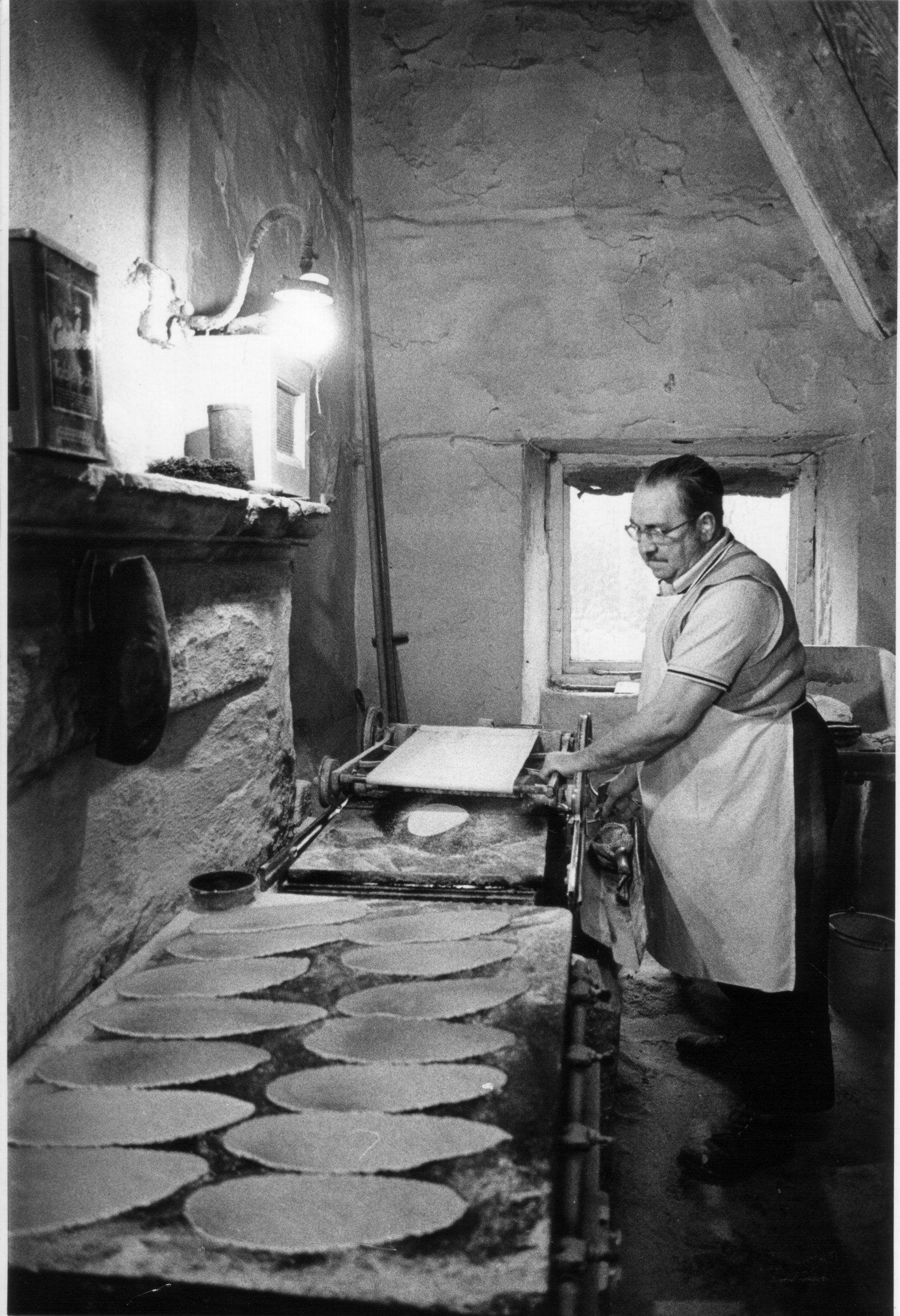 Alan making oatcakes early morning by gaslight, from the Family Archive